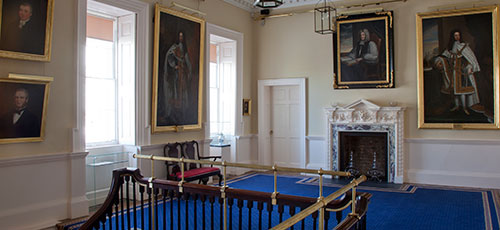 The elegant grand staircase to accommodate 18th century ladies' dresses